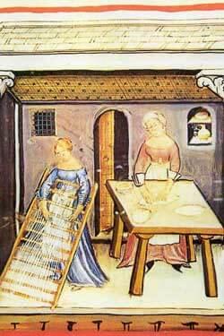 illustrazione medioevale di donne che preparano del cibo
